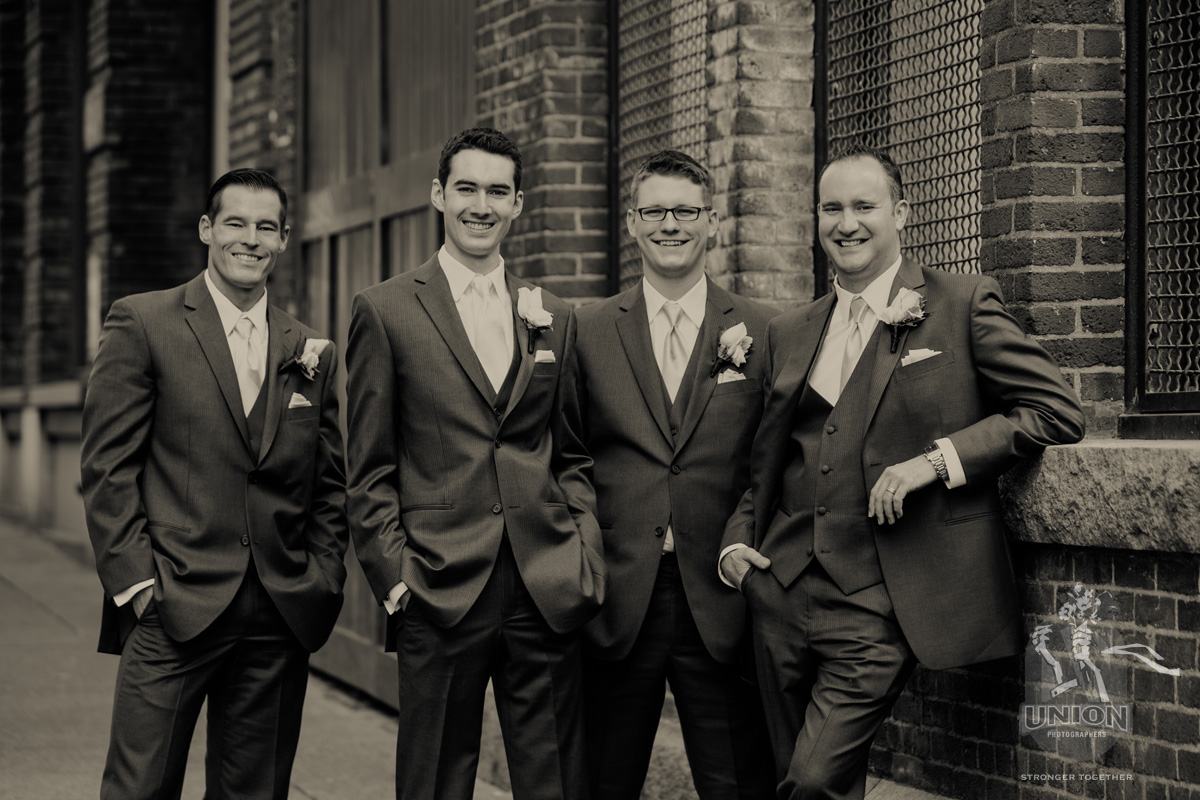 urban portrait of a groom and his groomsmen