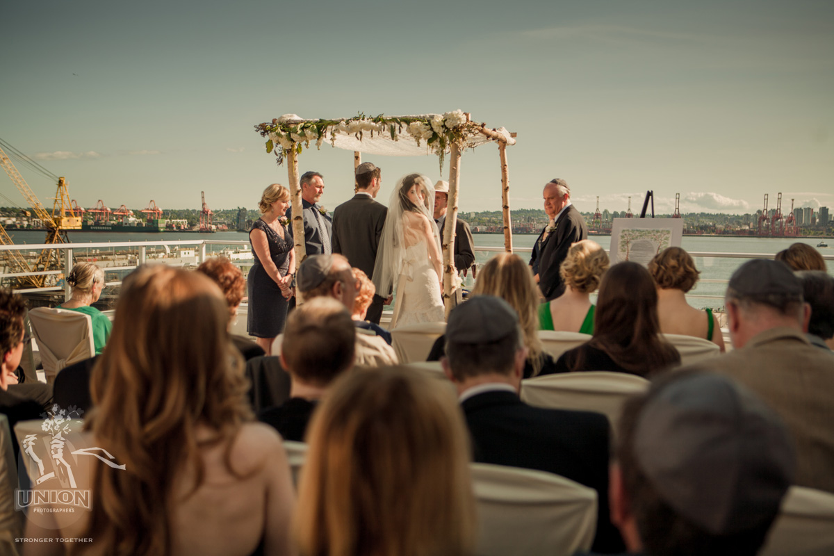 wedding ceremony on the deck at the Pinnacle Hotel