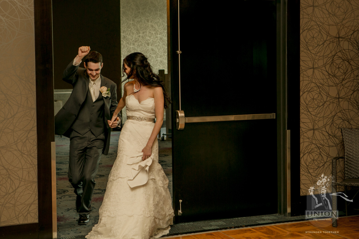 bride and groom entering their reception