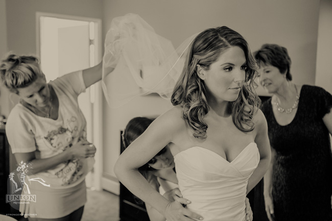 bride getting into her gown