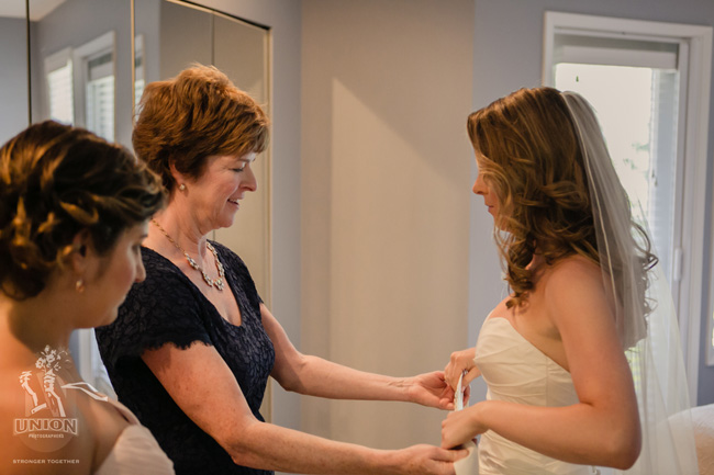 bride's mom helping her get ready