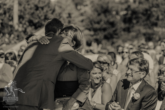 groom huggin his mom
