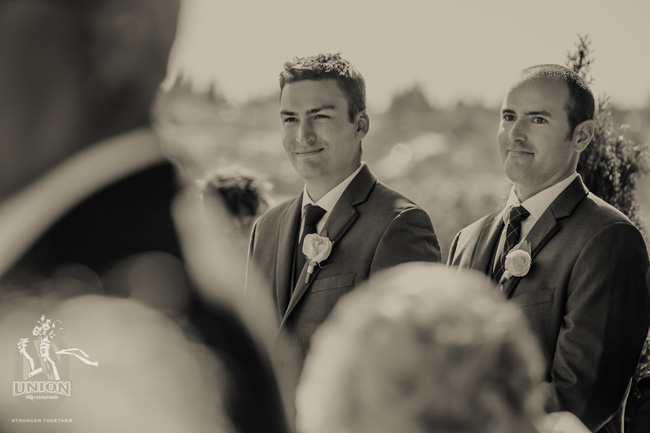 groom seeing his bride walk down the aisle