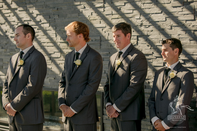 groomsmen standing up for the groom