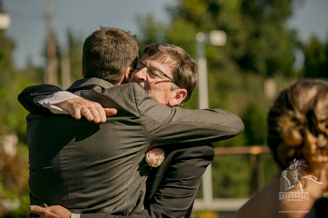 congratulatory hug from dad