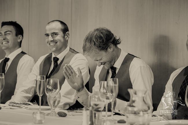 groomsmen laughing at speech