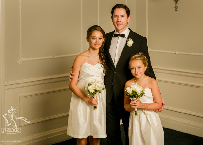 portrait of groom and his daughters