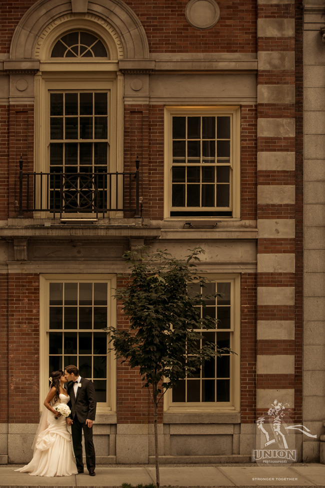 portrait of bride and groom with architecture