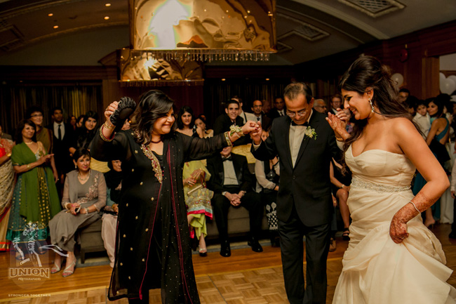 bride dancing with her parents