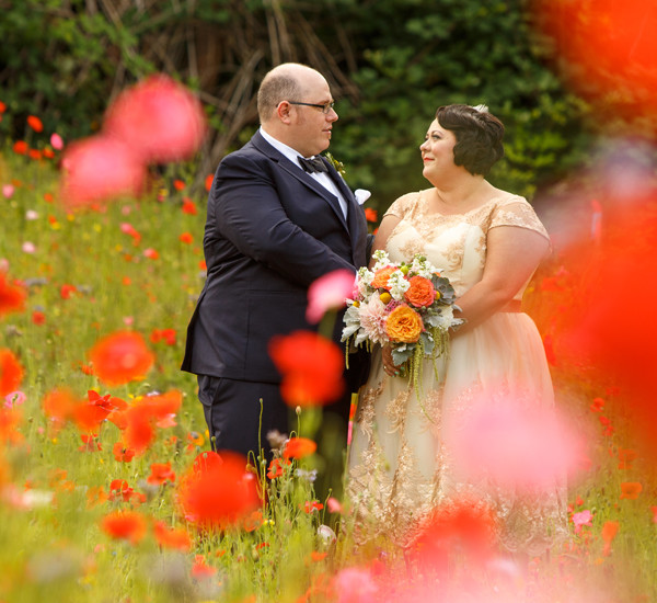 bride and groom portrait amoung the poppies