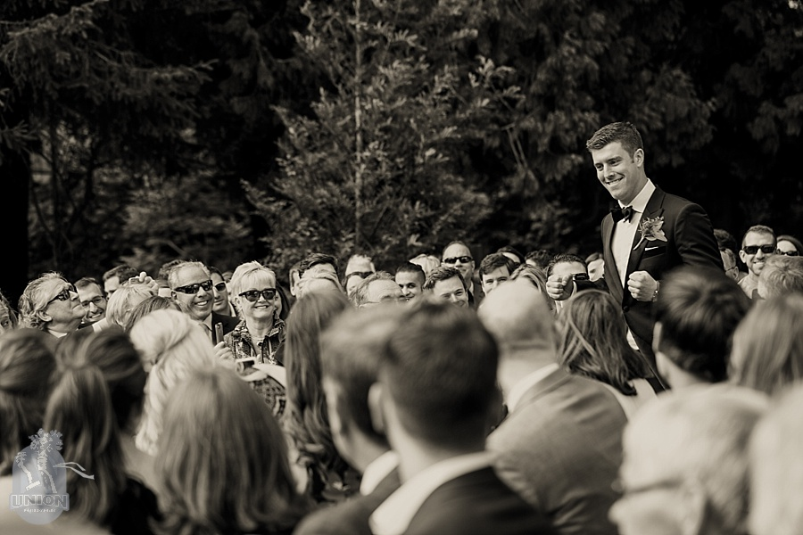 excited groom walking down the aisle at Hart house